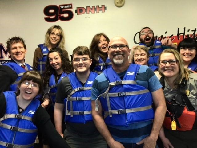 Photo Caption: Bold Gold Media staff and Park Ranger Susie Kaspar enthusiastically wear their life jackets to work.