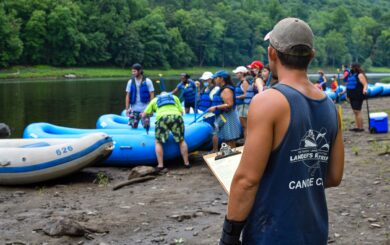 rafters getting safety talk by river