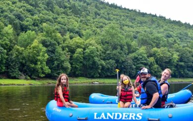 family in raft ready to raft down river