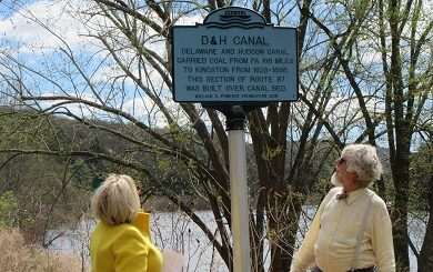 Man and woman looking at new D&H Canal historical marker