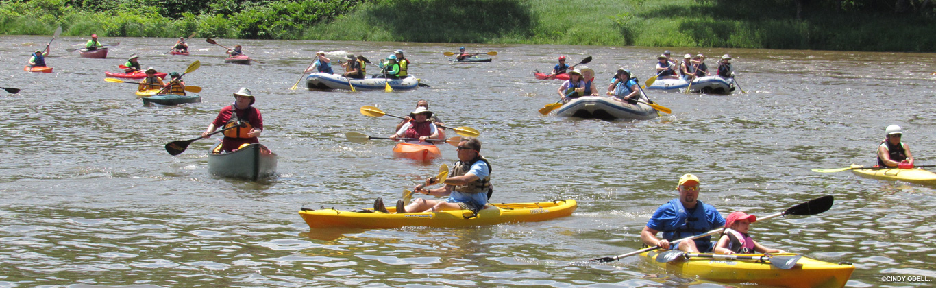 River Sojourn with dozens of rafters and kaykers
