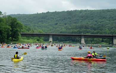 kayakers and canoes approaching the Robeling Bridge