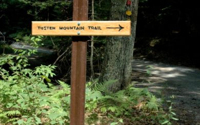 sign providing direction for trail