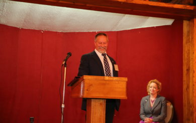 Chairman Brian W. Smith at podium