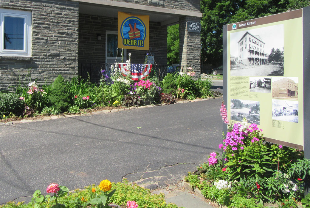 front of UDC office with summer flowers