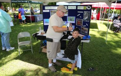 educational booth with kid dressed as an eagle