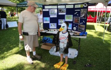 Promise Land State Park educational booth with kid dressed as an eagle