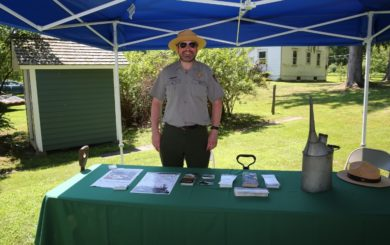 national park service ranger with historic forest fire fighting gear