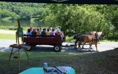 wagon ride being pulled by draft horses