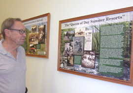 George Fluer reviewing the interpretive panels