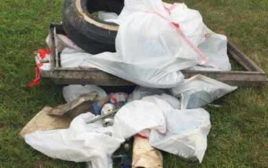 a pile of trash found during the river clean up