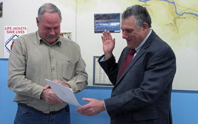 Aaron Robinson being sworn in as president